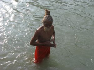 Sadhu bathing in Ganga